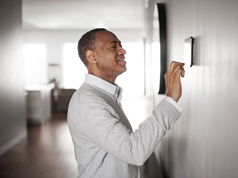 Man turning turning on Zoning System